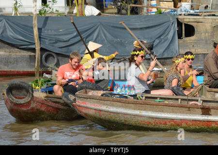 Phong Dien, Vietnam - December 31st 2017. Tourist on a boat tour at the Phong Dien Floating Market near Can Tho in the Mekong Delta - Stock Image