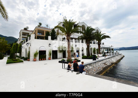 Seaside walkway in Porto Montenegro - High end real estate development with a luxury yacht marina. - Stock Image