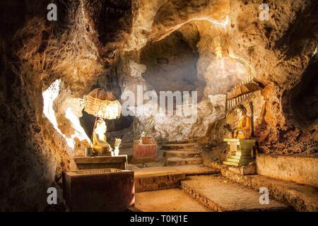 Light streams into an underground cave at Htet Eain Gu Cave And Monastery, Myanmar - Stock Image