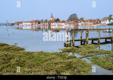 Picturesque old village reflected in still waters of Bosham Creek at high tide in Chichester harbour. Bosham, West Sussex, England, UK, Britain, Europ - Stock Image