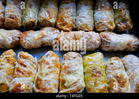 Home made food. Prepared for baking sarmi. Traditional meal with rice-stuffed cabbage leaves for Christmas Eve. - Stock Image