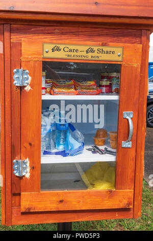HICKORY, NC, USA-10/14/18: A 'blessing box' allows people to leave food and other staples for those who may need them. - Stock Image
