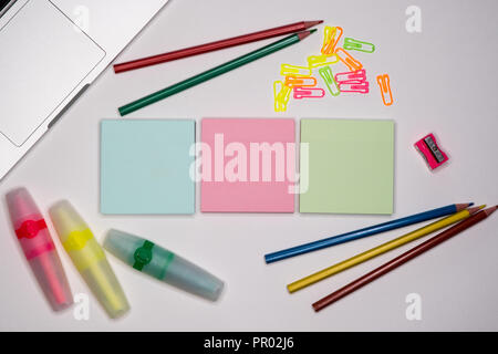Colorful sticky notes and stationery on office desctop. Text space, copy space. - Stock Image