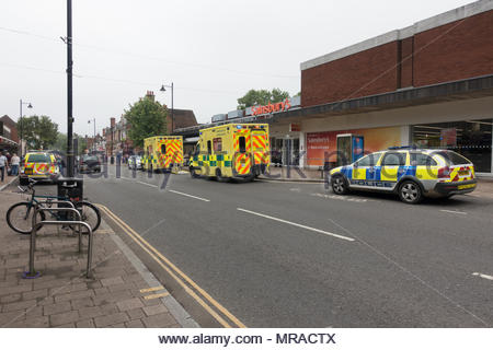 Fleet, Hampshire Ambulance and Police attending an incident in the Fleet branch of Sainsbury's after a customer suffered a medical problem. The customer was taken to hospital and later died. - Stock Image