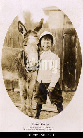 Desert Chums, boy and donkey, Las Vegas, Nevada, USA (Oasis Confectionery photo, Fremont Street, Las Vegas).      Date: 1910 - Stock Image
