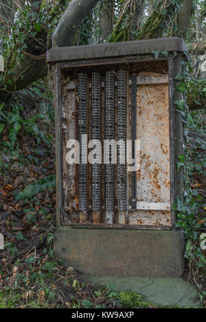 Old abandoned GPO telephone junction box at Lostwithiel, Cornwall. - Stock Image