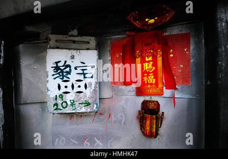 Old post box and incense holder, Tai O fishing village, Lantau, Hong Kong - Stock Image