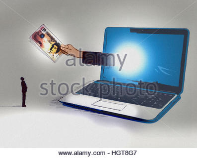 Businessman looking up at hand emerging from computer screen holding ten pound notes - Stock Image