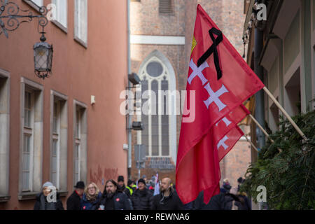Flag of the city of Gdansk decorated with black ribbon during funeral ceremony of mayor Pawel Adamowicz - Stock Image