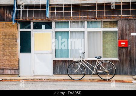 Old wooden house and bicycle in Shodoshima, Shikoku, Japan - Stock Image