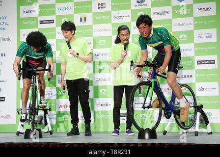 Tokyo, Japan. 14th May, 2019. Japanese comedy duo Total Ten Bosch member Kensuke Fujita (L) and comedy trip Panther member Takahiro Ogata (R) fight on bicycles as they attend a promotional event of the Tour de Tohoku 2019 fun ride in Tokyo on Tuesday, May 14, 2019. Tour de Tohoku is is an annual cycling event to support Tohoku region, northern Japan as a massive earthquake and tsunami attacked the region in 2011. Credit: Yoshio Tsunoda/AFLO/Alamy Live News - Stock Image