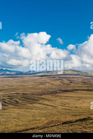 View from high on Cnoc Fola across the cut bogland towards the Seven Sisters of the Derryveagh Mountains, County - Stock Image