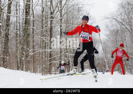 A competitor smiles while skiing on the  trail between Cable and Hayward, Wisconsin during the American Birkebeiner. - Stock Image
