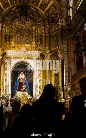 An ornate altar inside the Basilica Macarena in Seville - Stock Image