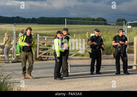 Stonehenge, Amesbury, UK, 20th June 2018,   Site marshalls and armed police observing arrivals at the summer solstice  Credit: Estelle Bowden/Alamy Live News. - Stock Image