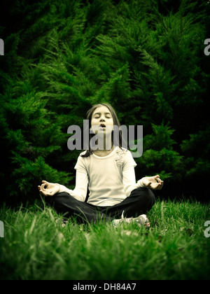 Girl, meditation, green - Stock Image