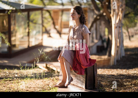 Senior woman sitting - Stock Image