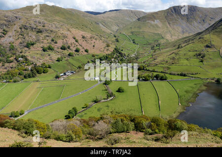 Hartsop Village and Brothers Water with the View Towards Brock Crags, The Knott and Gray Crag, from the Hartsop Above How path, Lake District, Cumbria - Stock Image