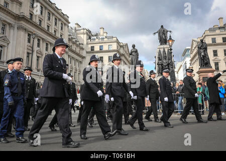 London, UK, 17th Mar 2019. Irish Police Force participants. London celebrates with a spectacular St Patrick's Day parade, led by this year's Grand Marshal, actor James Nesbitt. Now in its 17th year, the parade attracts more than 50,000 people for a colourful procession of Irish marching bands from the UK, US and Ireland, energetic dance troupes and spectacular pageantry. Credit: Imageplotter/Alamy Live News - Stock Image