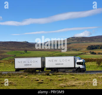 New Look Double-trailer HGV. M6 Northbound carriageway, Shap, Cumbria, England, United Kingdom, Europe. - Stock Image