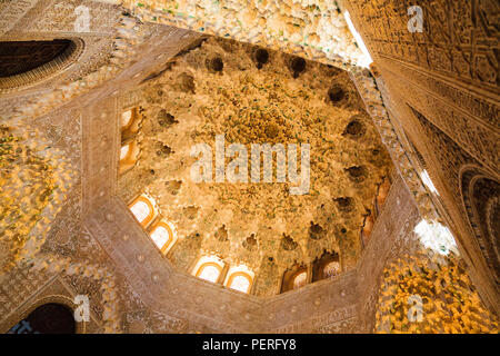 Looking up into ornate and decorative islamic architecture ceiling at the Alhambra Palace in Granada Spain - Stock Image