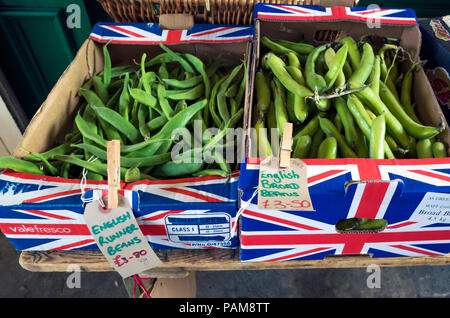 Greengrocers shop display of priced English Runner Beans and Broad Beans in boxes coloured with the Union Flag - Stock Image