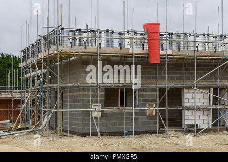 Scaffolding surrounding a house under construction on a housing development in Norfolk UK - Stock Image