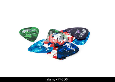 Celluloid guitar plectrums in a variety of colours and guages - Stock Image