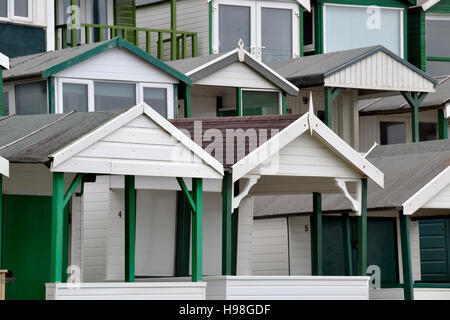 Green beach Huts at Langland Bay on Gower Peninsular - Stock Image