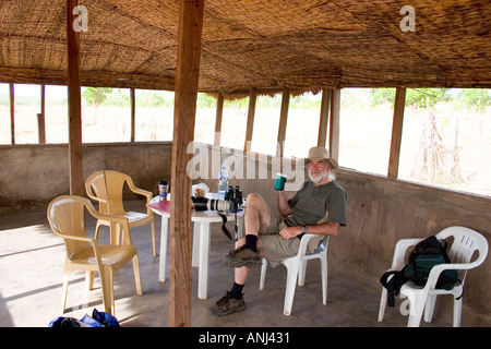 Pat Bennett relaxing in the shade at the Wechiau Hippo Sanctuary North Western Ghana - Stock Image