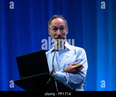 Geneticist David Reich explaining how ancient human DNA is providing suprising answers to the basic question of who we are and where we came from. on the Main Stage, at New Scientist Live - Stock Image