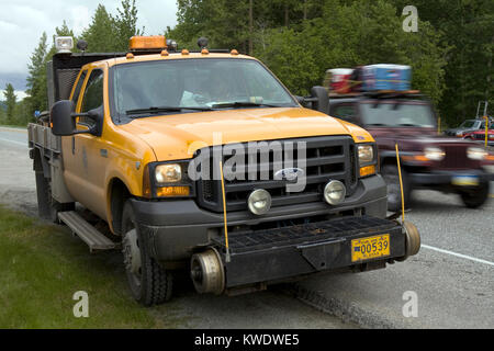Special prepared yellow, hi-rail truck for moving and working on railway tracks, parked on the side of one of the - Stock Image