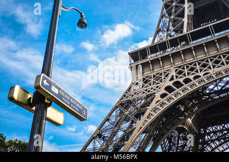 A sunny day in Paris France with a street sign for the batobus and the tour eiffel with the Eiffel Tower in the - Stock Image