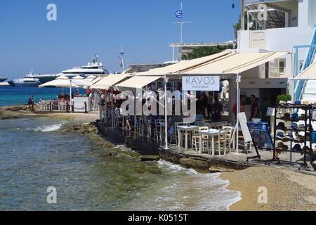 Waterfront restaurant on the Greek island of Mykonos - Stock Image