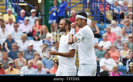 Eastbourne, UK. 25th June, 2019. Juan Sebastien Cabal (left) and Robert Farah of Colombia discuss tactics against Andy Murray and Marcelo Melo during their doubles match at the Nature Valley International tennis tournament held at Devonshire Park in Eastbourne . Credit: Simon Dack/Alamy Live News - Stock Image