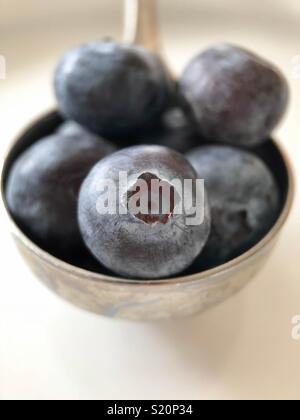 Tablespoon of blueberries - Stock Image