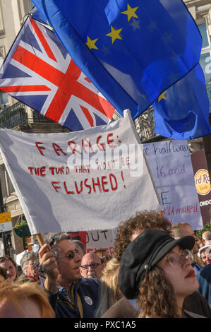 London, UK. 20th October 2018. People with placards, banners and flags on the People's Vote March including 'Farage: The Turd that won't be Flushed!'. They call for a vote to give the final say on the Brexit deal or failure to get a deal as the march leaves Hyde Park Corner. They say the new evidence which has come out since the referendum makes it essential to get a new mandate from the people to leave the EU. Peter Marshall/Alamy Live News - Stock Image