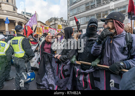 London, UK. 9th Dec, 2018. People wait to march holding a banner at the start of the united counter demonstration by anti-fascists in opposition to Tommy Robinson's fascist pro-Brexit march. The march which included both remain and leave supporting anti-fascists gathered at the BBC to to to a rally at Downing St. Police had issued conditions on both events designed to keep the two groups well apart. Credit: Peter Marshall/Alamy Live News - Stock Image