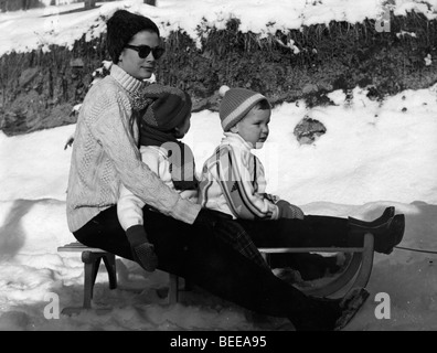 Grace Kelly sledding with her two youngest children, Albert and Stephanie. - Stock Image