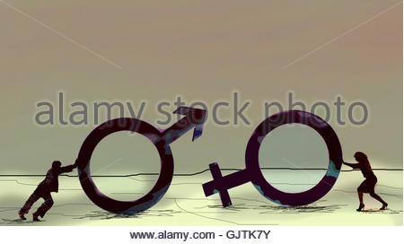Man and woman pushing large gender symbols - Stock Image