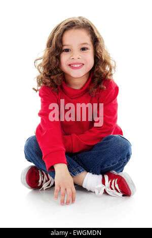Stock image of cute little girl sitting and smiling, isolated on white with shadow on floor - Stock Image