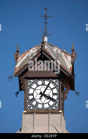 The clock on the clock tower at the V&A Waterfront on Cape Town, South Africa. Painted yellow for 2014 instead - Stock Image