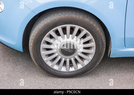 Wheel on a small Fiat 500 mini-car bearing the numerical model number on the wheel hub in UK - Stock Image