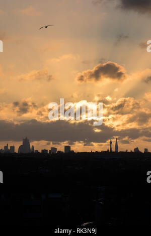 London, UK. 9th Feb 2019. UK Weather: View of the London Skyline from Wembley Park Sun rising behind the Shard and BT Tower. Credit: amanda rose/Alamy Live News - Stock Image