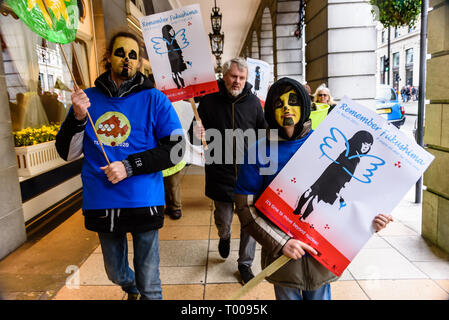 London, UK. 16th March 2019. Protesters march from the Japanese Embassy to a rally opposite Parliament to mark 8 years since the Fukushima meltdown of three nuclear reactors. 50,000 people are still refugees and many are being given no alternative but to move back into areas still heavily contaminated, and the clean-up is proving much more difficult than anticipated. Campaigners say nuclear power is unsafe and there should be no new nuclear plants but a much more rapid shift to renewables. Peter Marshall/Alamy Live News - Stock Image