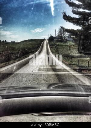 Rural road through  windshield in ohio - Stock Image