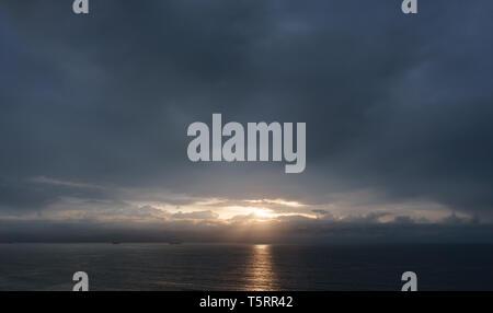 dark cloudscape sunset over the sea - Stock Image