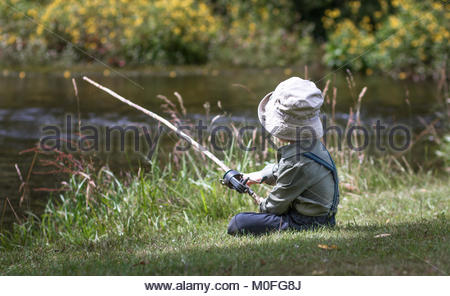 Little boy fishing with old-fashioned rod - Stock Image
