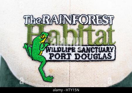 Crest on an Australian head cap promoting the Rainforest Habitat and Port Douglas - Stock Image