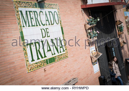 Sign saying Mercado de Triana on a brick wall at Triana Market Seville - Stock Image